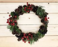 Beautiful wreath on the wooden background Stock Images