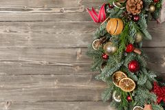 Beautiful Christmas wreath on wooden boards. Preparation for holidays concept. Flower shop is a master work of a. Professional florist royalty free stock image