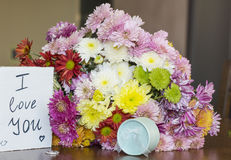 Beautiful  chrysanthemums bouquet with i love you card and ring Stock Image