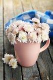Beautiful chrysanthemums in cup on the wooden background Royalty Free Stock Photos