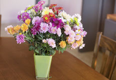 Beautiful chrysanthemums flowers in green glass vase Stock Photo
