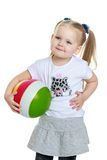 Beautiful chubby little girl with a ball in his Stock Image