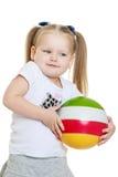 Beautiful chubby little girl holding a ball Stock Photography