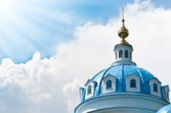 Beautiful church against blue cloudy sky. Stock Photo