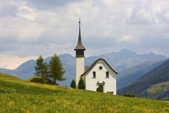 Beautiful church in alpine landscape Stock Image