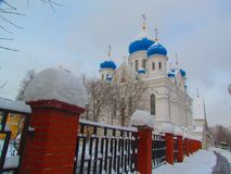 Beautiful Church with blue domes. Behind the fence in winter Stock Images