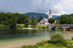 Beautiful church and bridge in Bohinj lake Royalty Free Stock Image