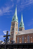 A beautiful church building with twin spires. Against a blue sky Royalty Free Stock Photo