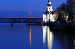 Beautiful church with illuminating at autumn night, lights reflected in the river Dnieper. stock image