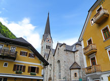 Beautiful Church and Maria Theresa Yellow Colored Architecture in Hallstatt Royalty Free Stock Photo