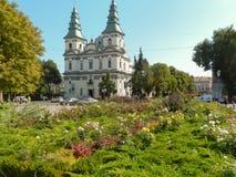 Beautiful church near flowerbed Stock Photo