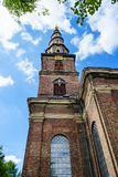 Beautiful Church of Our Savior. Copenhagen, Denmark, against the blue sky. Bottom view. Architecture. Sights Stock Photo