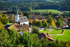 Beautiful church in typical small bavarian town in Germany. Majestic mountains in the background. Beautiful church in typical small bavarian town in Germany Royalty Free Stock Images