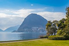 Beautiful Ciani park and view of Lake Lugano and the Monte San Salvatore, Switzerland royalty free stock images