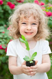 Beautiful cild with young plant Royalty Free Stock Photo