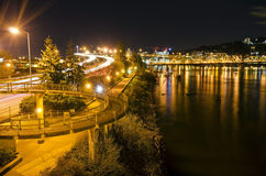 Circular walkway and city view in night time Royalty Free Stock Photos