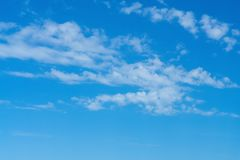 Beautiful cirrus clouds on bright blue sky.  stock images