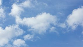 Blue Sky with White Clouds. Beautiful cirrus clouds moving across a summer blue sky. It can also be used as a transitional video, a meditative video, or for stock video footage