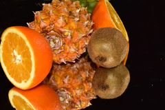 Beautiful citrus fruits close up on the mirror royalty free stock image