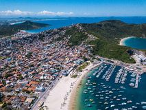 Beautiful city Arraial do Cabo Brazil. Praia dos Anjos. Aerial drone photo from above. Mountains ocean and fishing boats. Uncharted brazilian tourist stock photo