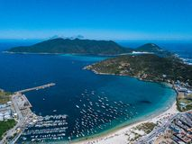 Beautiful city Arraial do Cabo Brazil. Praia dos Anjos. Aerial drone photo from above. Mountains ocean and fishing boats. Uncharted brazilian tourist stock images