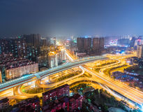 Beautiful city interchange at night. Wuhan cityscape skyline with urban traffic infrastructure background, China Royalty Free Stock Image