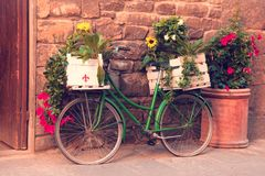 Beautiful city landscape with a green bike near the old wall wit royalty free stock photos