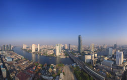 Beautiful city scape from sky scrapper in heart of bangkok capit. Al of thailand ,with important office building and chaophraya river curve against clear and Stock Images