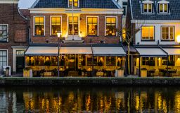 Beautiful city scenery at night with lighted buildings and the water reflecting the lights, Popular dutch city Alphen aan den Rijn royalty free stock photo
