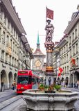 Beautiful City Street View of the colorful medieval Marksman statue on top of elaborate fountain in Bern, Switzerland. Stock Photo