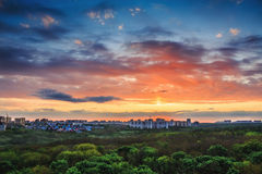 Beautiful city sunset HDR photo. Beautiful city sunset with many trees in the foreground, HDR photo Royalty Free Stock Photos