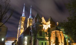 Magic architecture of Tumski Island at night. Beautiful city of Wroclaw situated on river Odra with illumination of night Gothic Catholic temples on the Tumski Stock Photography