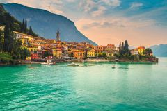 Beautiful cityscape with colorful houses, Varenna, Lake Como, Italy, Europe. Amazing luxury holiday resort, colorful villas and harbor with kayaks, boats stock image