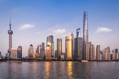 Beautiful cityscape with glass skyscrapers standing along the Huangpu River against the backdrop of the setting sun Royalty Free Stock Photography