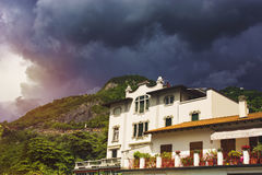 Beautiful cityscape of italian Varenna with building, green moun Stock Photography