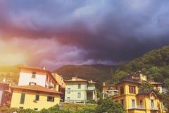 Beautiful cityscape of italian Varenna with building, green vall Stock Photo