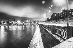 Beautiful cityscape, Moscow at night, the capital of Russia, cit. Y lights and reflection in the river, black and white image Stock Images