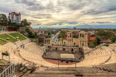 Plovdiv Roman theatre with ominous clouds. Beautiful cityscape of Plovdiv, Bulgaria, in the medieval part of the city called Old Town, with the ancient Roman royalty free stock image