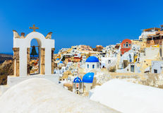 Beautiful cityscape of Santorini with the town of Oia on top of the volcanic hill. Stock Photos