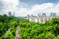 Beautiful cityscape in Singapore. Modern buildings among trees. Beautiful summer cityscape in Singapore. Modern buildings and road among green trees. Park in royalty free stock photos