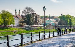 Beautiful cityscape of Uzhgorod in springtime. Uzhgorod, Ukraine - April 13, 2016: beautiful cityscape of the old central part of a town on the river Uzh in Royalty Free Stock Photos