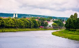 Beautiful cityscape of Uzhgorod town in summer. Embankments with linden and chestnut alley lead to ancient part of a town. Puppet theater and domes of Greek Royalty Free Stock Images