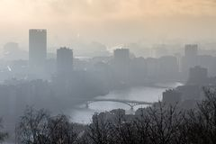 Hazy river Meuse in Liege. Beautiful cityscape view of the skyline of Liege, Belgium, with the river Meuse on a sunny and hazy winter day seen from the top of royalty free stock images