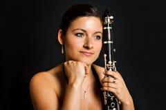Beautiful clarinetist women Royalty Free Stock Image
