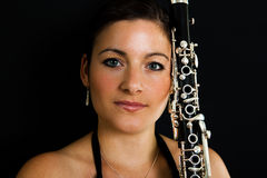 Beautiful clarinetist women Stock Image