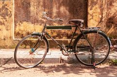 Ancient vintage bike on the street in Cochi, Kerala, India stock photography