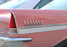 Tail fin on a vintage pink Chevy. Stock Images