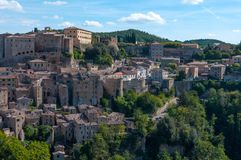 Beautiful classic panoramic view of the ancient town of Sorano in autumn, province of Grosseto, southern Tuscany, Italy. Classic panoramic view of the ancient Stock Images