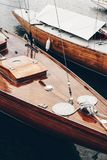 Beautiful classic wooden boats docked at the sea port on a still dark water, Helsinki - Finland stock photography