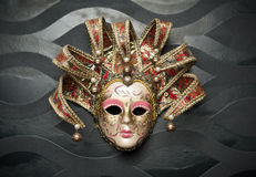 Beautiful classical mask from  Venice on black wall. Carnival mask Royalty Free Stock Photo